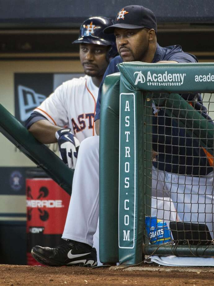 Astros manager Bo Porter and first baseman Chris Carter watch the action from the top step of the dugout during the first inning. Photo: Smiley N. Pool, Chronicle