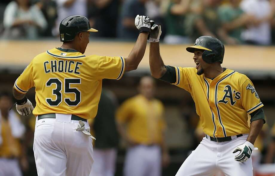 Coco Crisp is congratulated by Michael Choice after his fifth-inning home run gave the A's a 4-2 lead. Photo: Ben Margot, Associated Press