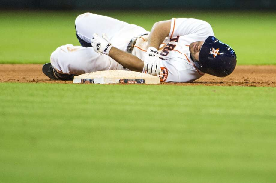 Jose Altuve lies on second base after being thrown out trying to stretch a leadoff single into a double during the ninth inning. Photo: Smiley N. Pool, Chronicle