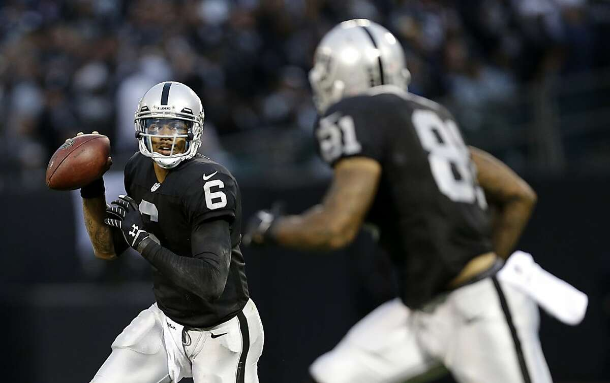 Oakland Raiders quarterback Terrelle Pryor (6) looks toward tight end Mychal Rivera (81) against the Dallas Cowboys during the first half of an NFL preseason football game in Oakland, Calif., Friday, Aug. 9, 2013. (AP Photo/Marcio Jose Sanchez)
