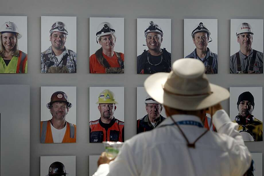 Bridge workers were photographed in a wall assemblage inside the Bridge Yard building Monday September 2, 2013. The celebration for the opening of the eastern span of the Bay Bridge began with a ceremony in the Bridge Yard building near the toll plaza. Photo: Brant Ward, The Chronicle