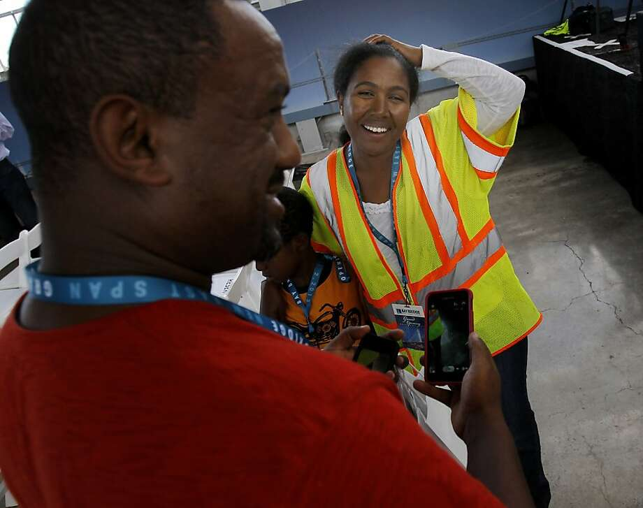 Masti Bogale, a bridge inspector, attended the event with her family Monday September 2, 2013. The celebration for the opening of the eastern span of the Bay Bridge began with a ceremony in the Bridge Yard building near the toll plaza. Photo: Brant Ward, The Chronicle