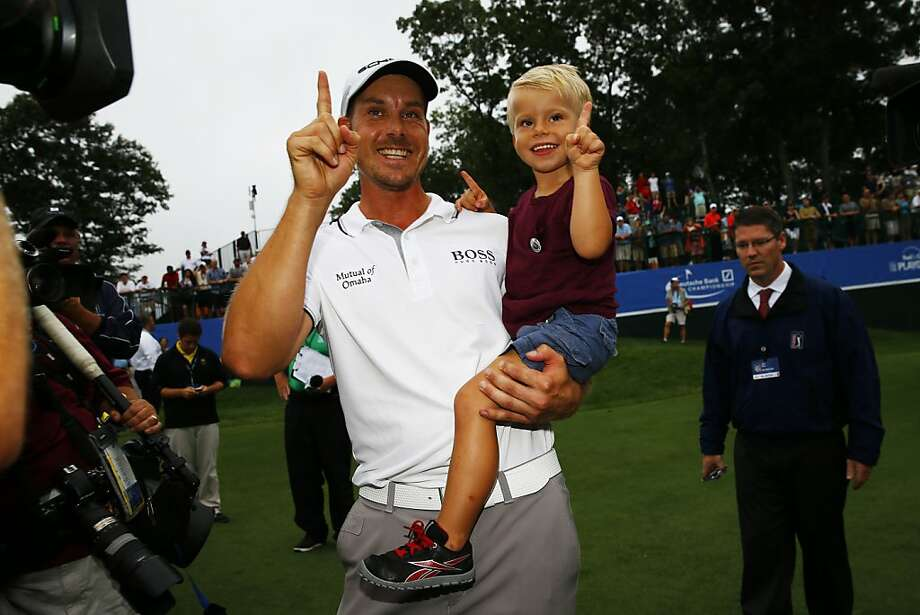 Henrik Stenson celebrates his victory with his son, Karl. Photo: Jared Wickerham, Getty Images