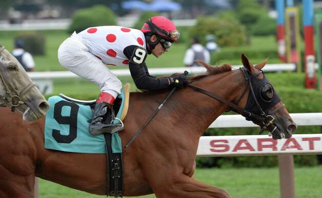 Junior Alvarado rides Lady Cohiba to the win in the 18th running of the Glens Falls  Sept. 2, 2013,  at the Saratoga Race Course in Saratoga Springs, N.Y.  (Skip Dickstein/Times Union) Photo: SKIP DICKSTEIN