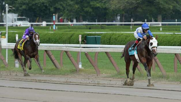 Jockey Jose Ortiz completely overpowered the field with Strong Mandate to win the 109th running of The Hopeful  Sept. 2, 2013,  at the Saratoga Race Course in Saratoga Springs, N.Y.  (Skip Dickstein/Times Union) Photo: SKIP DICKSTEIN