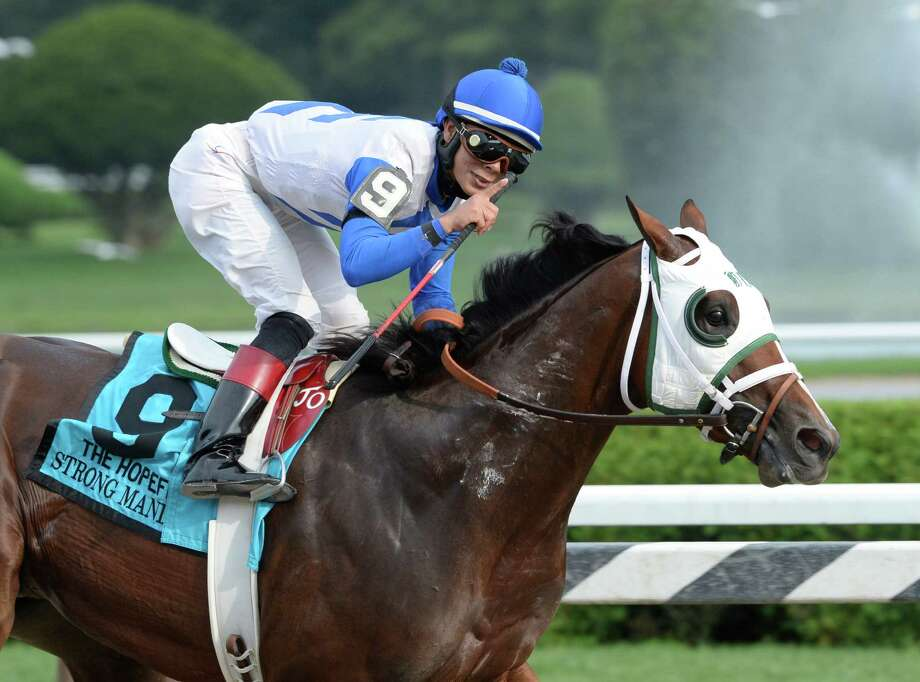 Jockey Jose Ortiz gives the number one sign as he completely dominated the field with Strong Mandate to win the 109th running of The Hopeful  Sept. 2, 2013,  at the Saratoga Race Course in Saratoga Springs, N.Y.  (Skip Dickstein/Times Union) Photo: SKIP DICKSTEIN
