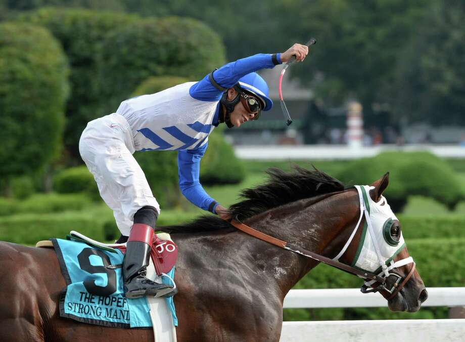 Jockey Jose Ortiz is jubilant as he completely dominated the field with Strong Mandate to win the 109th running of The Hopeful  Sept. 2, 2013,  at the Saratoga Race Course in Saratoga Springs, N.Y.  (Skip Dickstein/Times Union) Photo: SKIP DICKSTEIN