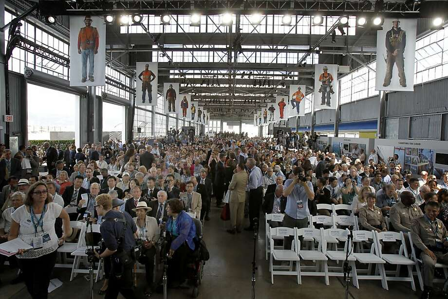 Hundreds filled the Bridge Yard for the event Monday September 2, 2013. The celebration for the opening of the eastern span of the Bay Bridge began with a ceremony in the Bridge Yard building near the toll plaza. Photo: Brant Ward, The Chronicle