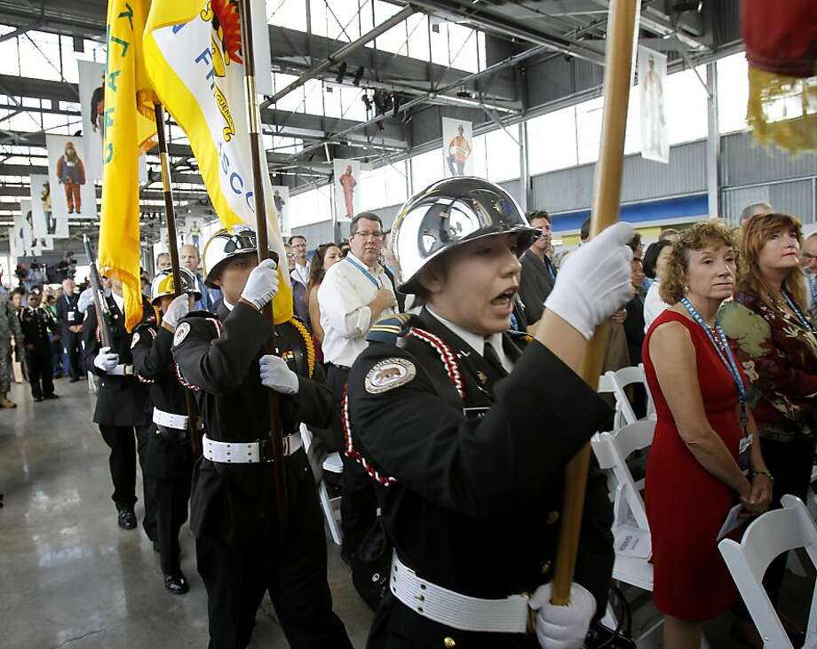 A Color Guard began the ceremony Monday September 2, 2013. The celebration for the opening of the eastern span of the Bay Bridge began with a ceremony in the Bridge Yard building near the toll plaza. Photo: Brant Ward, The Chronicle