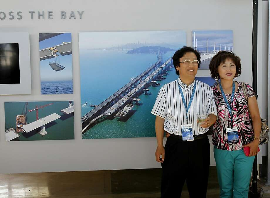 The Lee family posed for a picture in the Bridge Yard building Monday September 2, 2013. The celebration for the opening of the eastern span of the Bay Bridge began with a ceremony in the Bridge Yard building near the toll plaza. Photo: Brant Ward, The Chronicle