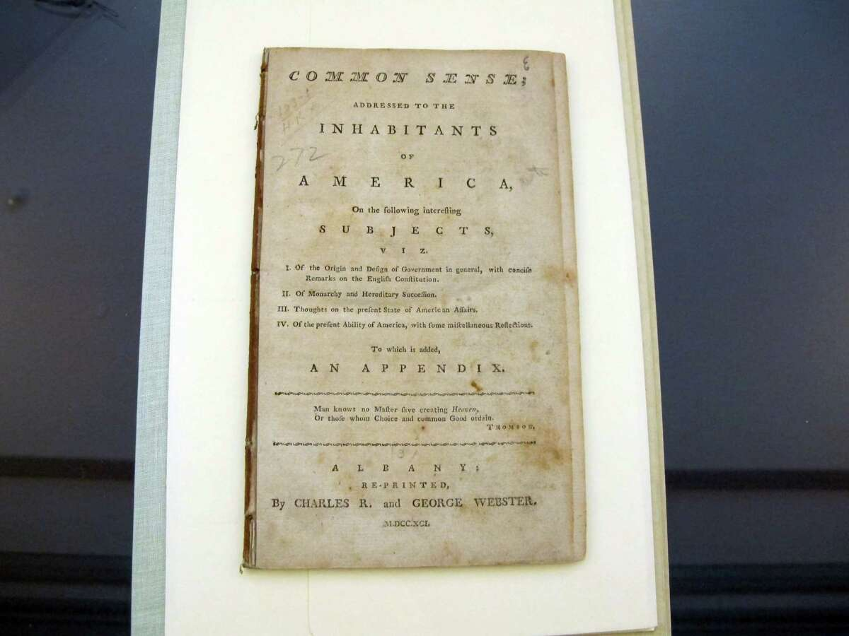 In this Tuesday, Aug. 20, 2013 photo, an early edition of Thomas Paine's