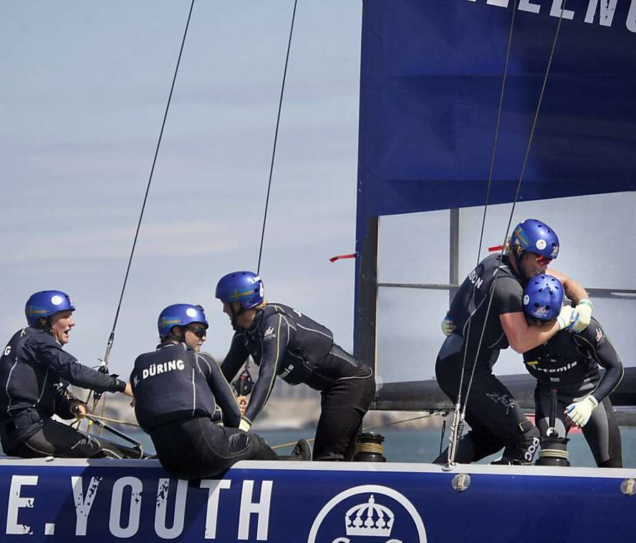 Crew members aboard Swedish Youth Challenge celebrate their victory in Race 4 of the Red Bull Youth America's Cup. Photo: Lea Suzuki, The Chronicle