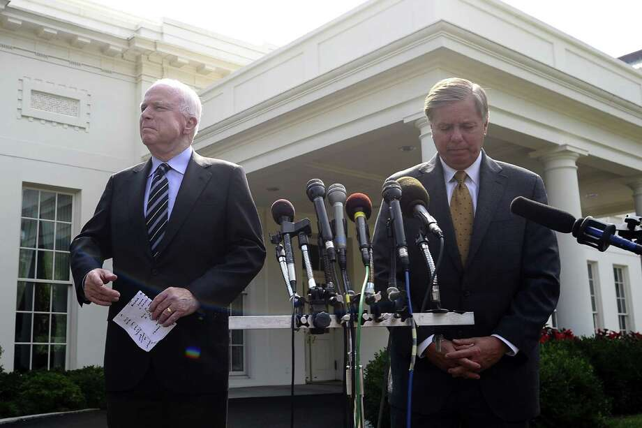 John McCain (left), with fellow senator Lindsey Graham, advocates more arms support for Syria's opposition forces. Photo: Jewel Samad / AFP / Getty Images