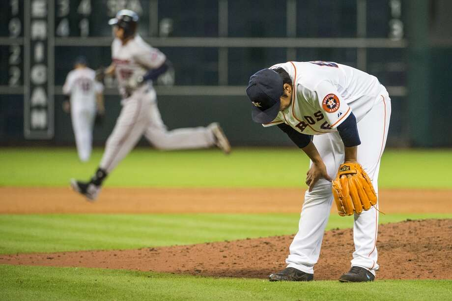 Sept. 2: Twins 10, Astros 6Reliever pitcher Chia-Jen Lo couldn't watch after serving up a grand slam to Chris Colabello in the ninth inning.  Record: 45-92. Photo: Smiley N. Pool, Chronicle