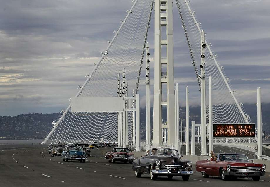 A group of vintage automobiles are some of the first to cross the new eastern span Monday September 2, 2013. The celebration for the opening of the eastern span of the Bay Bridge began with a ceremony in the Bridge Yard building near the toll plaza, followed by a chain cutting ceremony nearby. Photo: Brant Ward, The Chronicle
