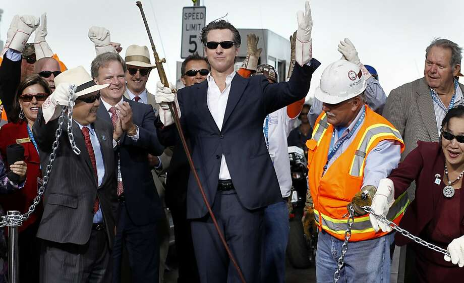 Lt. Gov. Gavin Newsom (center) celebrates with other politicians and dignitaries after the chain-cutting ceremony to open the eastern span of the Bay Bridge. Photo: Brant Ward, The Chronicle