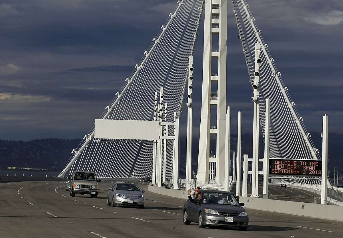 The sun hit the bridge as cars drove over the new eastern span Monday September 2, 2013.