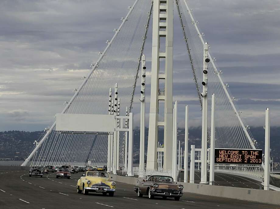A group of vintage automobiles are some of the first to cross the eastern span Monday September 2, 2013. The celebration for the opening of the eastern span of the Bay Bridge began with a ceremony in the Bridge Yard building near the toll plaza, followed by a chain cutting ceremony nearby. Photo: Brant Ward, The Chronicle