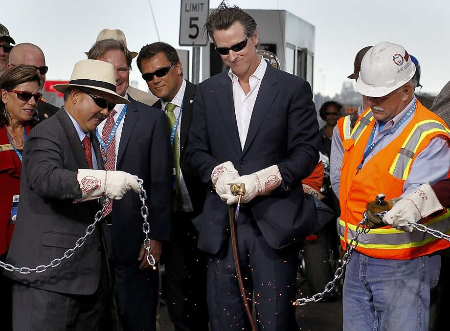 The chain breaks and the bridge is opened Monday September 2, 2013. The celebration for the opening of the eastern span of the Bay Bridge began with a ceremony in the Bridge Yard building near the toll plaza, followed by a chain cutting ceremony nearby. Photo: Brant Ward, The Chronicle