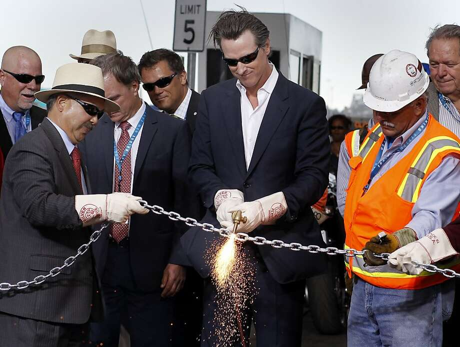 Lt. Governor Gavin Newsom did the honors with a torch to open the bridge Monday September 2, 2013. The celebration for the opening of the eastern span of the Bay Bridge began with a ceremony in the Bridge Yard building near the toll plaza, followed by a chain cutting ceremony nearby. Photo: Brant Ward, The Chronicle