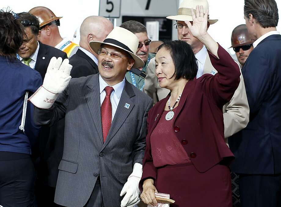 Mayor Ed Lee of San Francisco and Jean Quan of Oakland waved to friends at the chain cutting Monday September 2, 2013. The celebration for the opening of the eastern span of the Bay Bridge began with a ceremony in the Bridge Yard building near the toll plaza, followed by a chain cutting ceremony nearby. Photo: Brant Ward, The Chronicle