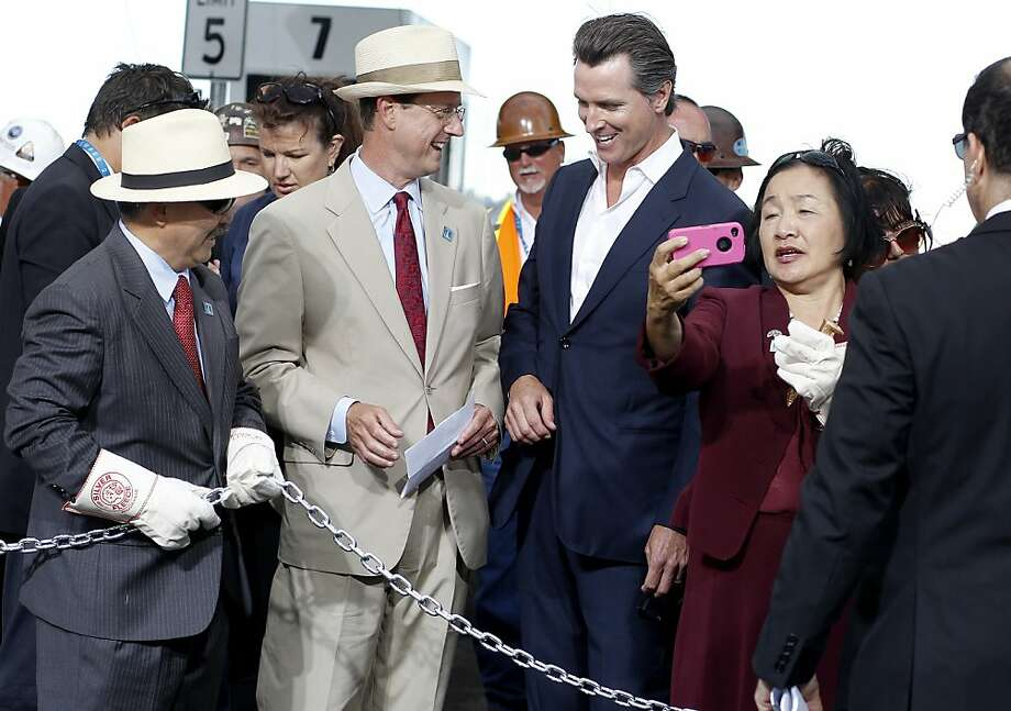 Dignitaries including Ed Lee (left), Steve Heminger, Gavin Newsom, and jean Quan enjoyed a little play before the chain cutting ceremony Monday September 2, 2013. The celebration for the opening of the eastern span of the Bay Bridge began with a ceremony in the Bridge Yard building near the toll plaza, followed by a chain cutting ceremony nearby. Photo: Brant Ward, The Chronicle