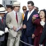 Dignitaries including Ed Lee (left), Steve Heminger, Gavin Newsom, and jean Quan enjoyed a little play before the chain cutting ceremony Monday September 2, 2013. The celebration for the opening of the eastern span of the Bay Bridge began with a ceremony in the Bridge Yard building near the toll plaza, followed by a chain cutting ceremony nearby.