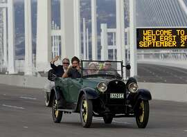 Classic cars were some of the first to cross the bridge Monday September 2, 2013. The celebration for the opening of the eastern span of the Bay Bridge began with a ceremony in the Bridge Yard building near the toll plaza, followed by a chain cutting ceremony nearby.