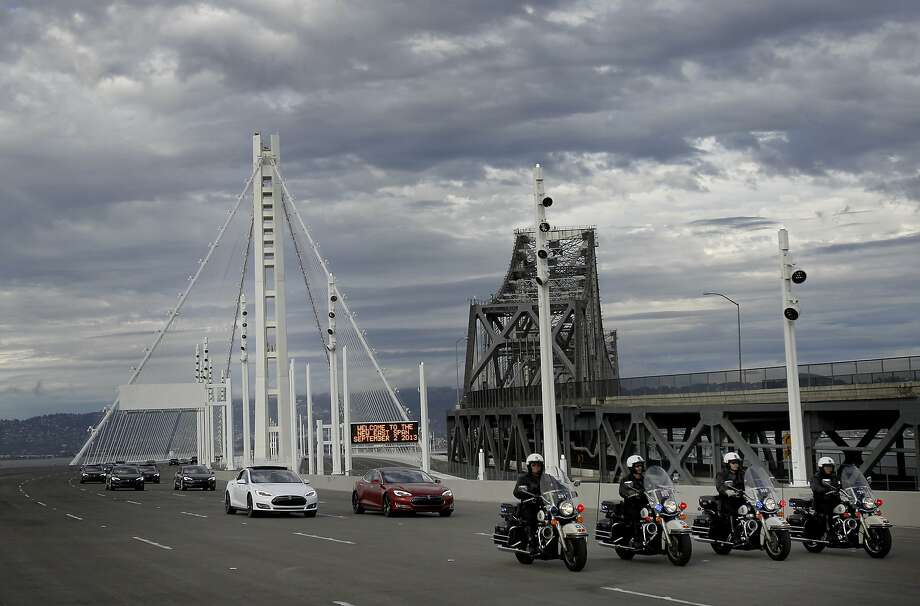 Motorcycle police escorted a group of cars over the new span for the first time Monday September 2, 2013. The celebration for the opening of the eastern span of the Bay Bridge began with a ceremony in the Bridge Yard building near the toll plaza, followed by a chain cutting ceremony nearby. Photo: Brant Ward, The Chronicle