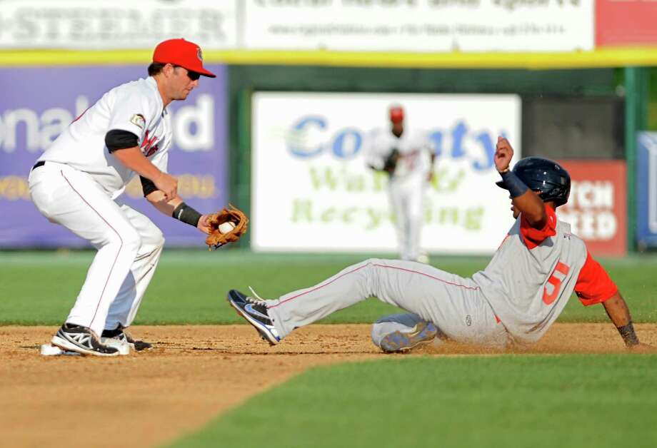 Tri-City ValleyCats second baseman Ryan Dineen gets Brooklyn Cyclones base runner Jonathan Clark out while trying to steal second during a baseball game at Joe Bruno Stadium on Monday, Sept. 2, 2013 in Troy, N.Y.  (Lori Van Buren / Times Union) Photo: Lori Van Buren / 00023640A