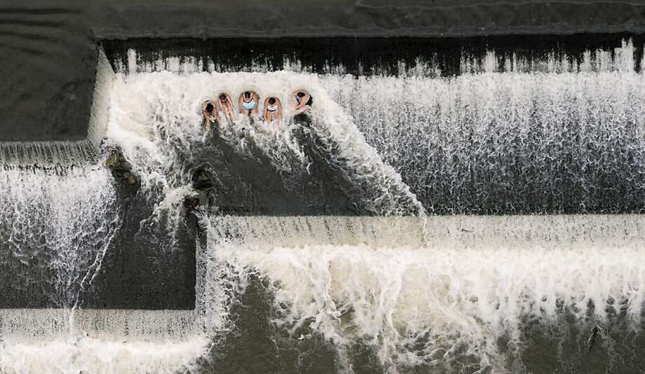 Guys, this is a darn good dam: Five swimmers cool off on the first level of the Benton Dam in Benton, Pa. Photo: Jimmy May, Associated Press