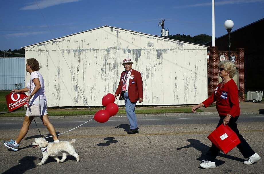 Dr. Larry Roller (center) of Mount Sydney, Va. walks with the Mark Obenshain campaign group in the 43rd annual Buena Vista Labor Day Parade in Buena Vista, Va. on Monday, Sept. 2, 2013.  Photo: Rebecca Barnett, Associated Press