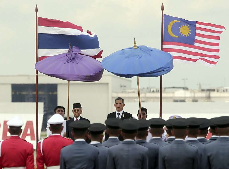 Malaysia's King Abdul Halim Mu'adzam Shah, center left facing camera, and Thai Crown Prince Vajiralongkorn, second right, review the honor guard during a welcome ceremony upon the arrival at the military airport in Bangkok, Thailand Monday, Sept. 2, 2013. The Malaysian King and Queen are on a four-day official visit to Thailand. Photo: Apichart Weerawong, Associated Press
