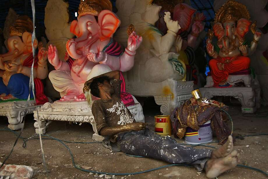 An Indian artist takes a rest as he prepares idols of elephant-headed Hindu god Ganesh ahead of Ganesh Chaturthi festival at a workshop in Hyderabad, India, Monday, Sept. 2, 2013. Ganesh Chaturthi, which begins from Sept. 9, is celebrated as the birthday of Lord Ganesha who is widely worshiped by Hindus as the god of wisdom, prosperity and good fortune.  Photo: Mahesh Kumar A., Associated Press