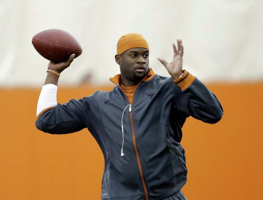 FILE - In this March 26, 2013 file photo, Former University of Texas and NFL quarterback Vince Young throws during Texas' Pro Day in Austin, Texas. The Green Bay Packers have signed free agent Young as a backup quarterback, Tuesday, Aug. 6, 2013. The 6-foot-5, 230-pound quarterback spent five seasons with the Tennessee Titans and one season with the Philadelphia Eagles. He was with the Buffalo Bills during the 2012 preseason.   (AP Photo/Eric Gay, File) Photo: Associated Press / AP