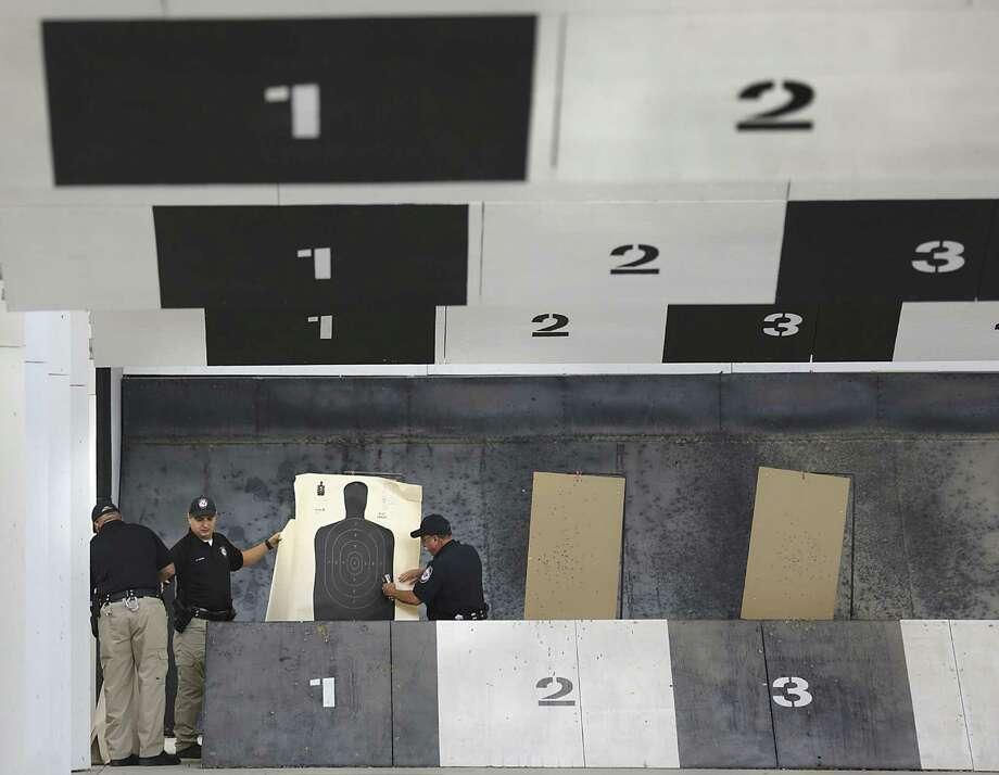 Texas A&M University-San Antonio police officers prepare for shooting practice at the Bexar County Firing Range. Photo: Bob Owen / San Antonio Express-News