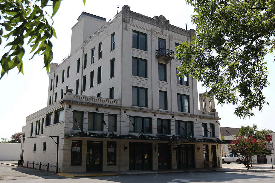 The Park Plaza Building in Seguin, Texas was recently purchased by Remote Logistics International with the intent of converting the building into housing for oil and gas executives. The building has undergone various iterations from a hotel to an office building. Many of the building's unique details from the days of being a hotel remain.  Photo: San Antonio Express-News / ©2013 San Antonio Express-News