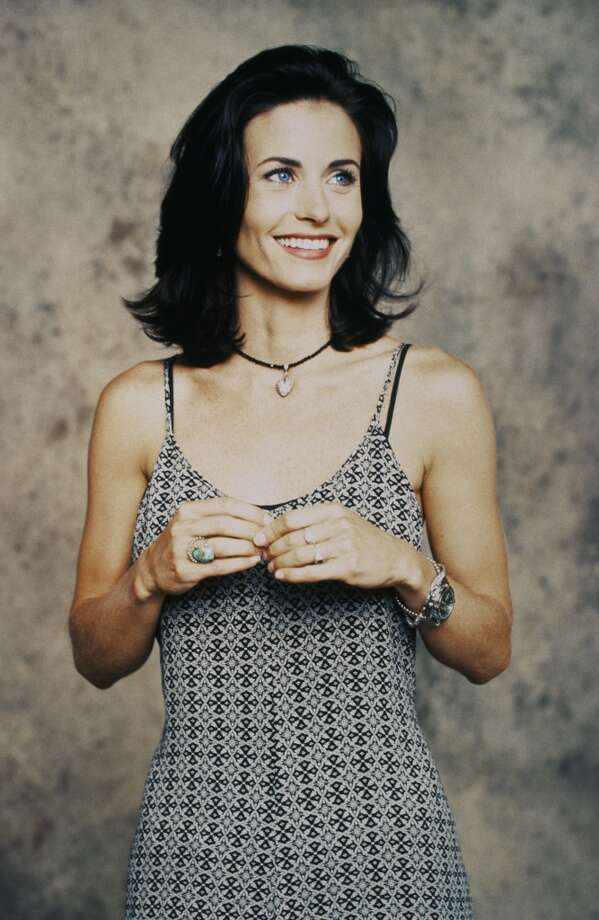 Courteney Cox as Monica Geller in a very of the era print dress. Note also the near choker necklace, another popular '90s look. Photo: NBC, NBC Via Getty Images