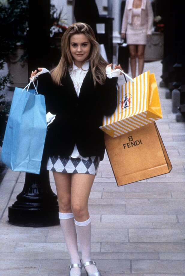 "Alicia Silverstone holding shopping bags in a scene from 'Clueless,' 1995. Silverstone's designer-conscious, sophisticated school girl looks were a reaction against the ""kinderwhore"" and grunge looks earlier in the decade. Photo: Archive Photos, Getty Images"