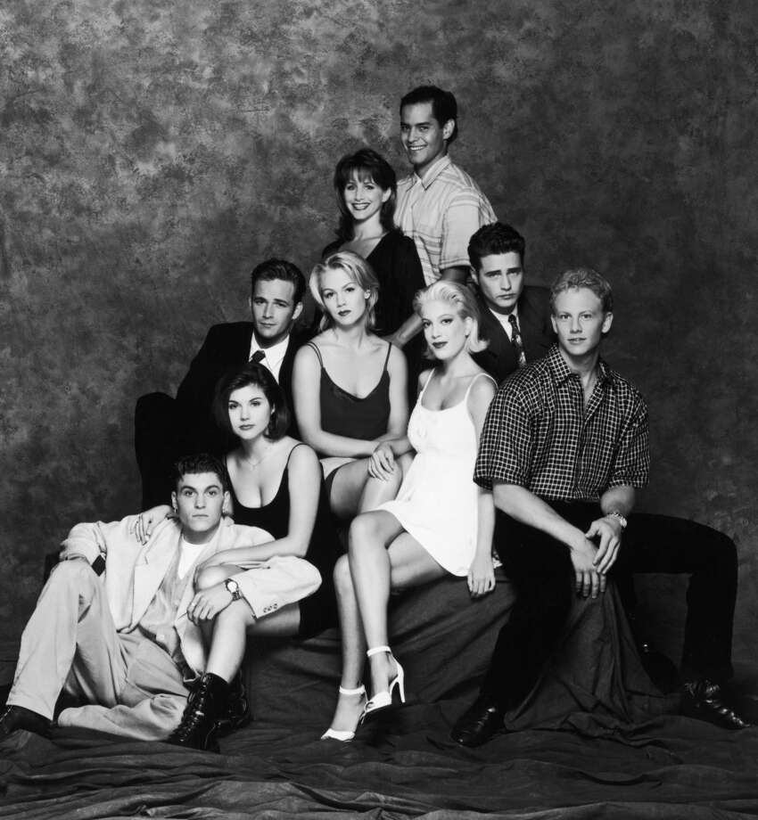 "The entire cast of ""Beverly Hills, 90210."" So many 90's trends in one photo: how many can you spot? Photo: Fox Broadcasting, Getty Images"