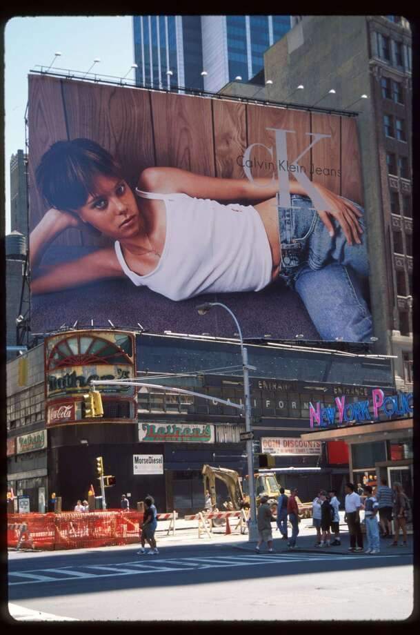A Calvin Klein advertisement is displayed on a billboard in Times Square August 23, 1995 in New York City. The advertising campaign, which included print ads and television spots, incited nationwide controversy because of its similarity to child pornography but came to be seen as signature ads of the era. Photo: Evan Agostini, Getty Images
