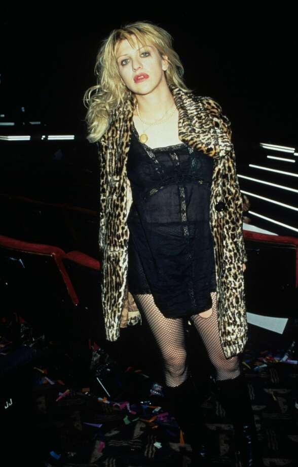 Courtney Love in two of her grunge signatures: slip dresses and leopard coats. Photo: Kevin.Mazur, WireImage