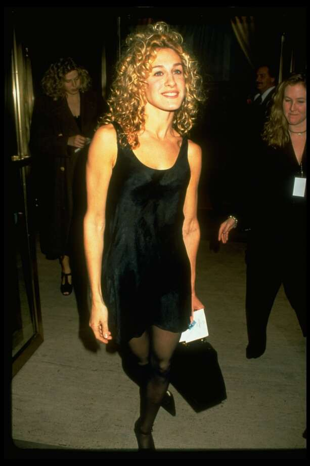 Actress Sarah Jessica Parker wearing simple short black dress by Calvin Klein. The short black Calvin Klein dress in the '90s was to the decade what the little black Chanel dress was to earlier decades. Photo: Robin Platzer, Time & Life Pictures/Getty Image