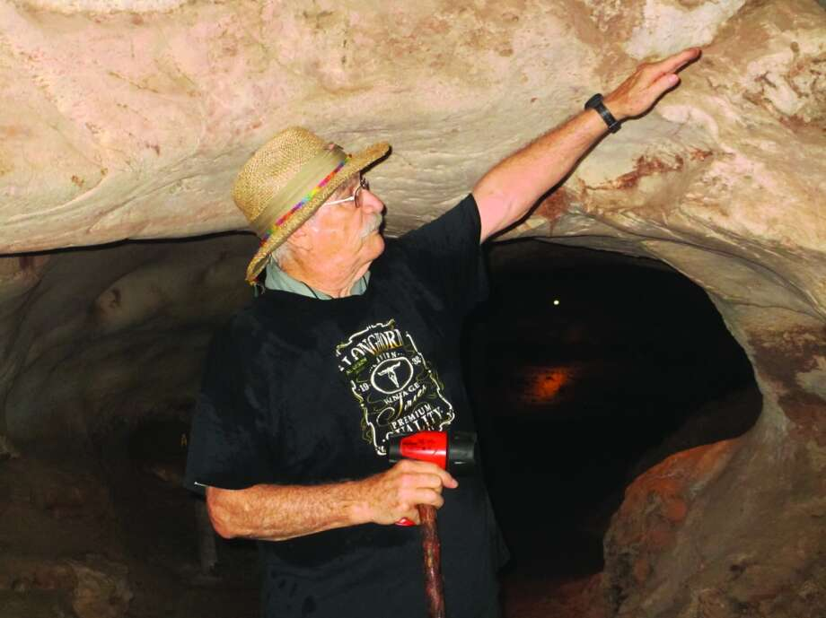 Al Gerow, a tour guide at Longhorn Cavern, is thought to be one of the oldest paid tour guides in the state park sytem, leading at least six tours a week. He's the on-site geologist after retirining from a career as a geologist and engineer for oil companies. Photo: Terry Scott Bertling, San Antonio Express-News