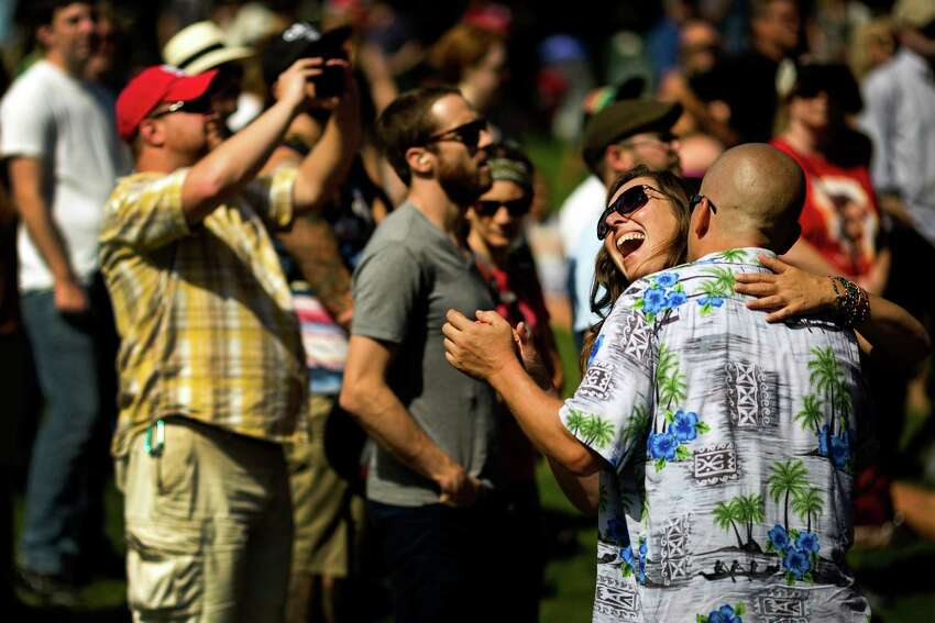 Onlookers dance to the sound of The Maldives on the third and final day of the annual Bumbershoot arts and music festival Monday, September 2, 2013, at Seattle Center in Seattle.