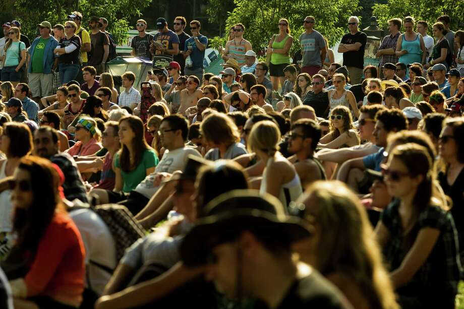 Onlookers enjoy a performance by The Sheepdogs on the third and final day of the annual Bumbershoot arts and music festival Monday, September 2, 2013, at Seattle Center in Seattle. Photo: JORDAN STEAD, SEATTLEPI.COM / SEATTLEPI.COM