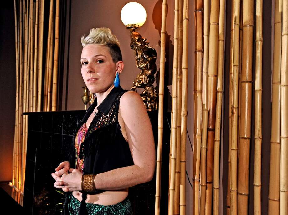 Jenny Miller, photographed at Pho Four Seasons on Dowlen. Styled by Larena Head. Wearing: Blanket-print bustier from Forever21, black fringe top from Stellar Treasure, printed pants from PacSun, Lavender Wedges from Kohls, teardrop earrings from NV Boutique, copper cuff from Earthbound, pyramid ring from Forever21. Randy Edwards/cat5 Photo: Randy Edwards, Beaumont Enterprise