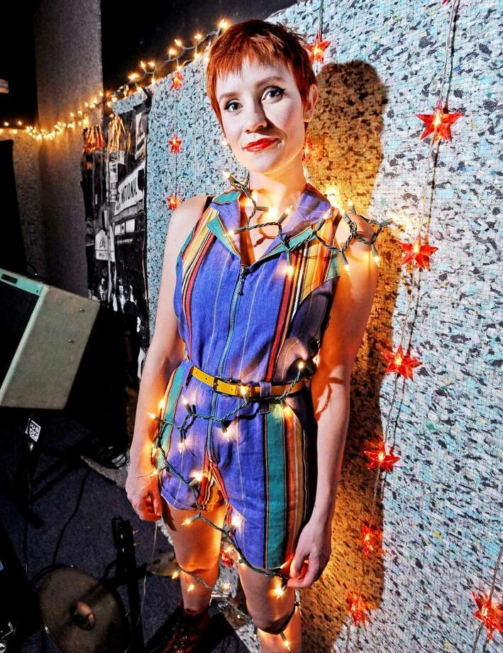 Haley Hardin, photographed at the downtown Jam Rooms. Styled by Grace Mathis. Wearing: Romper from Taxi Taxi in Houston, belt from Goodwill Beaumont, resale boots, Black Jacket from a friend's late grandmother. Randy Edwards/cat5 Photo: Randy Edwards, Beaumont Enterprise
