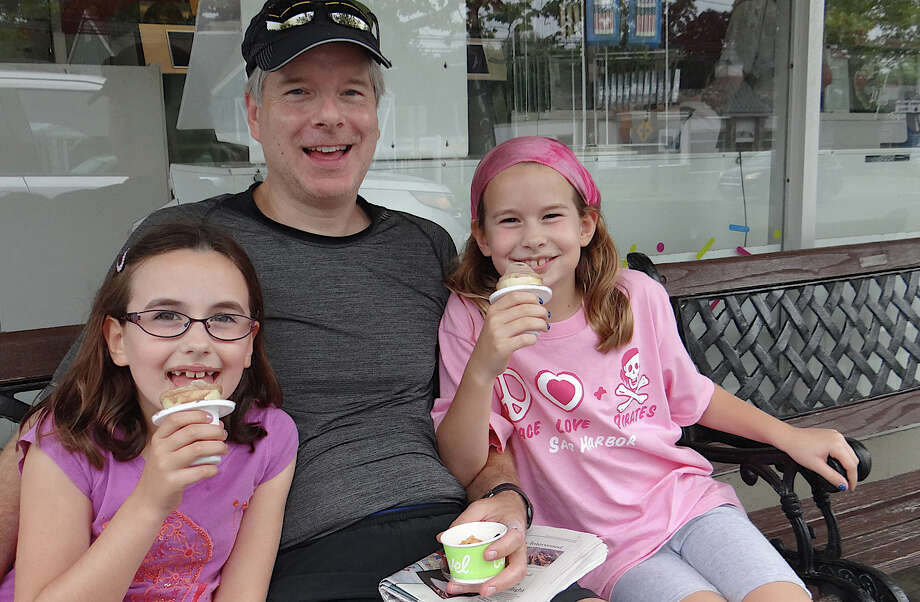 Adam Clemens of Westport and daughters Hannah, 7, and Sophie, 9, enjoyed ice cream at Carvel and planned to bike ride or play tennis later on their Labor Day holiday. Photo: Mike Lauterborn / Westport News contributed