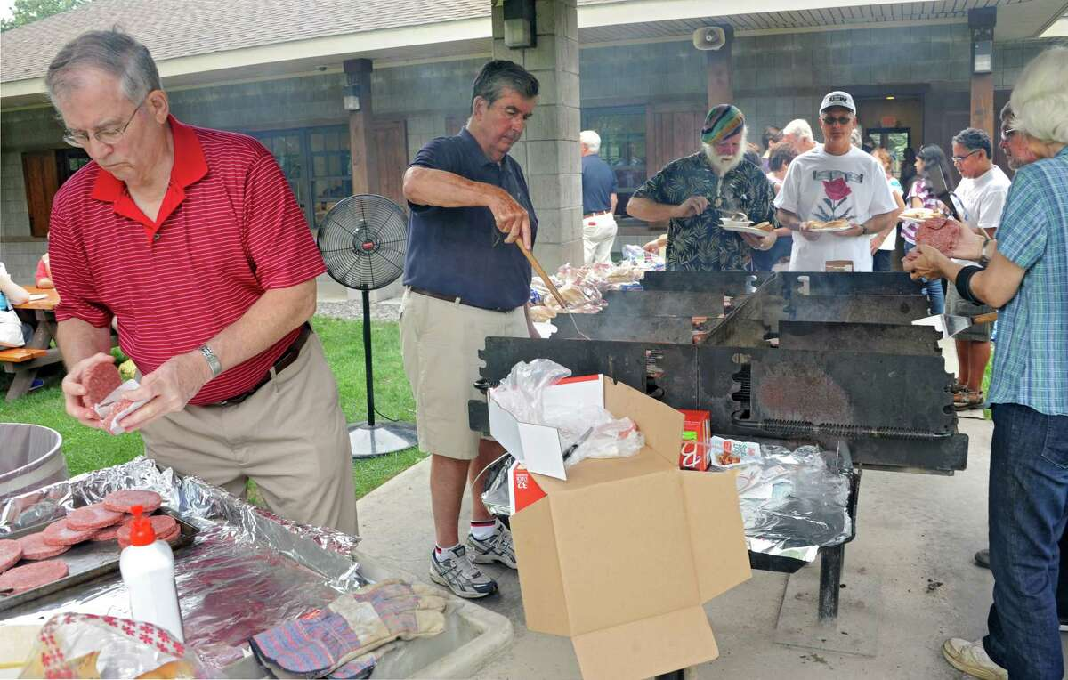 Former Albany County Executive Mike Breslin, left, and his brother Senator Neil Breslin cook hamburgers and hotdogs during the Solidarity Labor Day picnic held at Cook Park on Monday, Sept. 2, 2013 in Colonie, N.Y. (Lori Van Buren / Times Union)